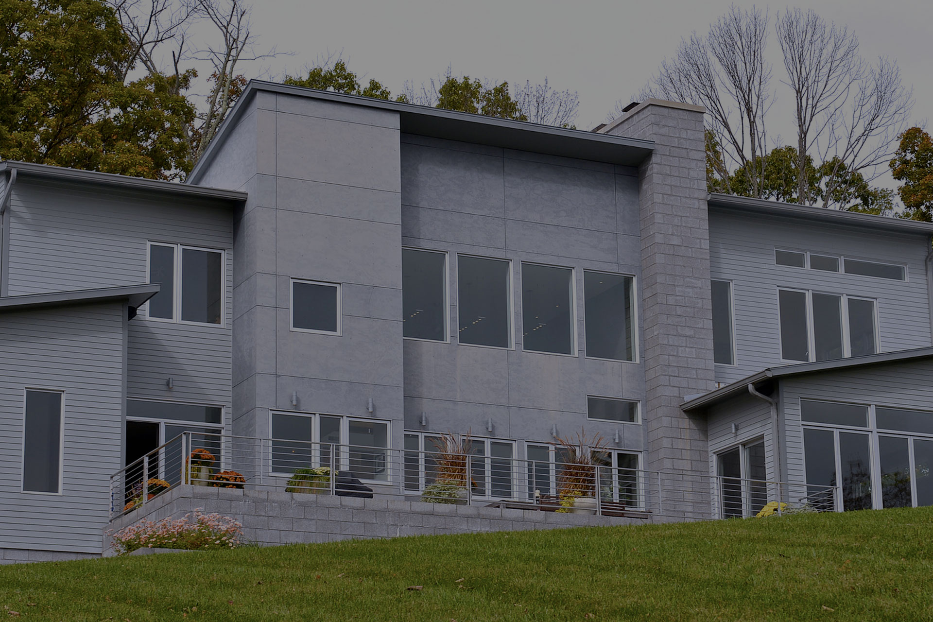 grey house with several windows